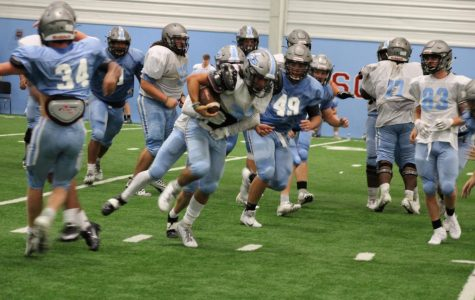 Football Team practices for upcoming season.