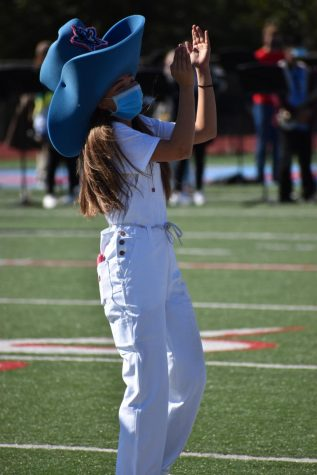 Marsha the Maverick (Emily Fincher) cheers on the crowd during the football homecoming pep rally.