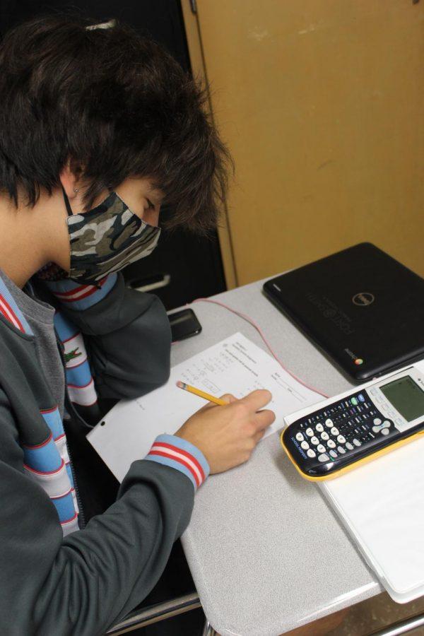Isaac Teague working on math homework.