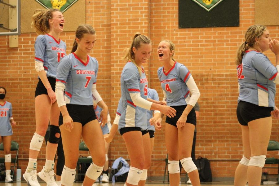 Volleyball team celebrates score in game against Bentonville.