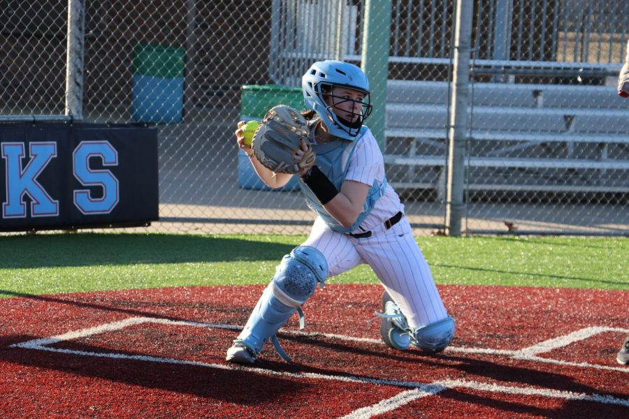 Softball Player Madi Conklin Catches At First Home Game