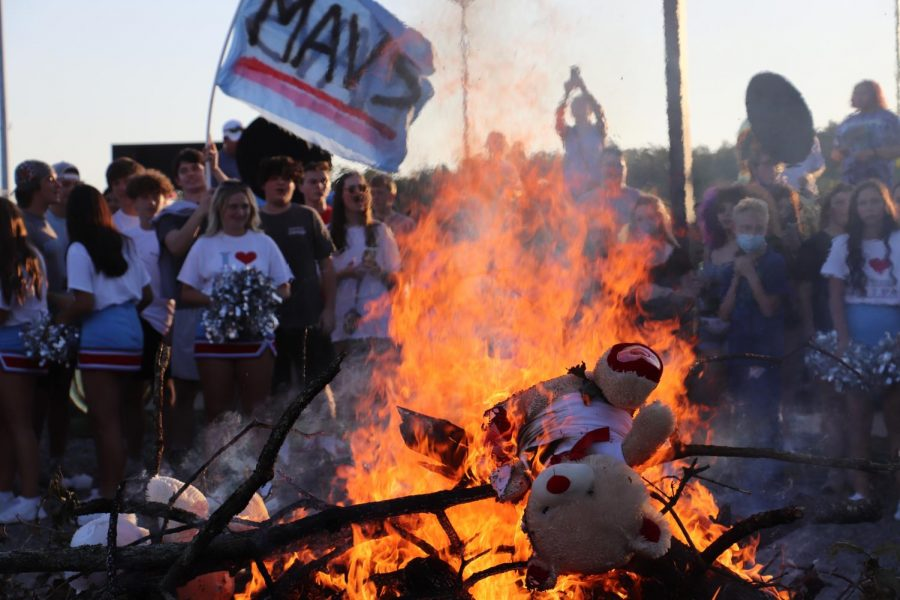 Stuffed bears burn at the Aug. 25 Bear-B-Que in the gravel stadium lot as a pre-event to the Northside rivalry game.