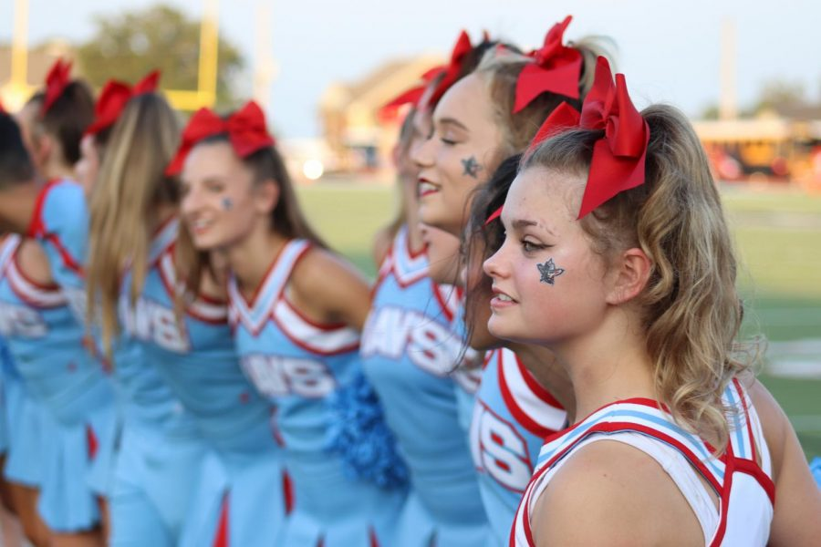 Junior Madison Kinsey sways with her squad before the game on Aug. 26 to the Alma Mater.