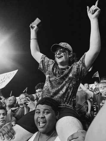 Camo-clad fans cheer on the Mavs during the Battle of Rogers Avenue on Aug. 26.