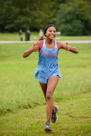 Judith Ramirez crosses the finish line at the cross country meet on September 12th.