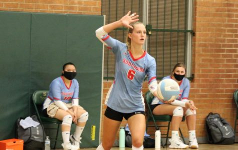 Hannah Hogue serves during volleyball game against Northside.