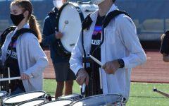 Jacob Weaver playing at the football homecoming pep rally.