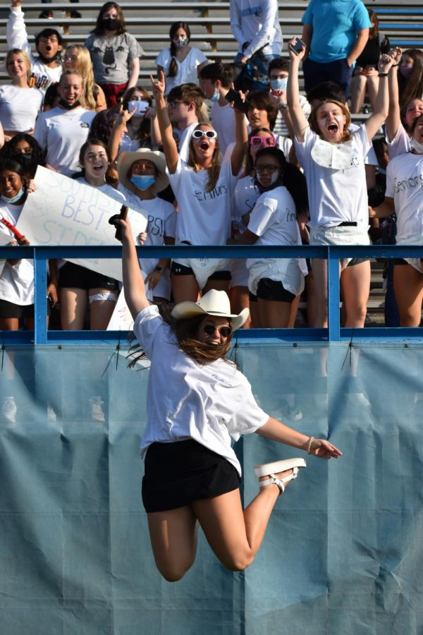 Section leader Abby Holycross pumps up the seniors during the first pep rally of the year on Aug. 26.
