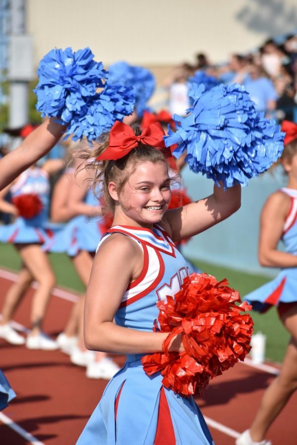 Cheer squad junior Madison Kinsey performs to Fat Gold Chain during the pep rally on Aug. 26.