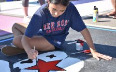 Senior Kiara Smiley paints spot 89 on Sept. 18. Smileys design included a frog wearing a cowboy hat.